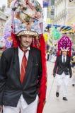 力耶卡,克罗地亚- 3月02 :被掩没的人参加在每年狂欢节队伍力耶卡, 2014年3月02日的克罗地亚 免版税库存照片