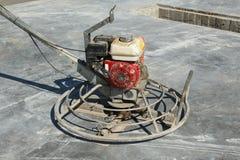 力量在建造场所的修平刀机器 免版税库存照片