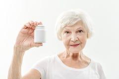 劝告的老妇人健康的药剂 免版税库存照片
