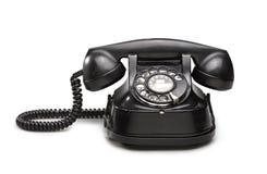 办公室:老和葡萄酒电话黑色 免版税库存图片