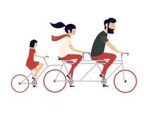 年轻加上儿童骑马自行车 库存图片