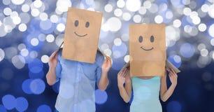 加上在纸板箱的emojis在bokeh 免版税库存照片