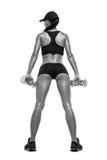 加大的训练的健身运动的妇女干涉与哑铃 免版税图库摄影