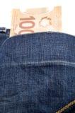 加拿大人在后面口袋的100美元 库存图片