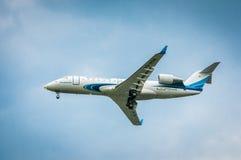 加拿大人的地方喷气机200ER VQ-BSB— Yamal航空公司 在l前 免版税库存照片