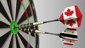 加拿大和叙利亚的旗子击中目标的舷窗的箭的 概念性的国际合作或的竞争 影视素材
