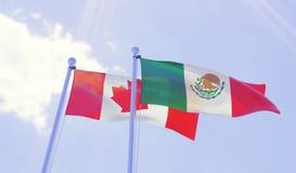 加拿大和墨西哥,挥动反对蓝天的旗子 免版税图库摄影