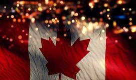 加拿大国旗光夜Bokeh摘要背景 免版税库存照片