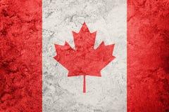 加拿大标志grunge 与难看的东西纹理的加拿大旗子 库存照片