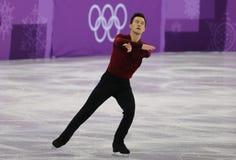 加拿大的奥林匹克冠军陈伟群在队事件单打运动员滑冰执行任意滑冰在2018个冬季奥运会 免版税库存图片