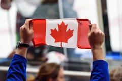 加拿大的旗子在手上 免版税库存图片