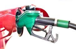 加油在加油站的一辆红色汽车 图库摄影