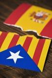 加泰罗尼亚的亲独立旗子和西班牙旗子 免版税图库摄影