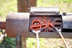 加热在燃烧器的两个烙铁 图库摄影