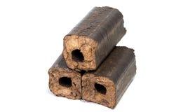 加热的代用燃料eco燃料生物燃料可更新的木冰砖 免版税库存图片