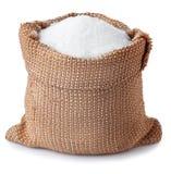加糖在白色背景隔绝的袋子的粒子 免版税库存照片