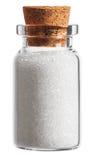 加糖在白色隔绝的一个小的瓶的香料 库存图片