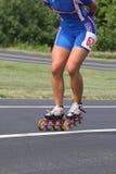 加速线型冰鞋和溜冰者滑冰的摘要  免版税库存图片