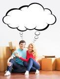 移动一个新的家的年轻夫妇 免版税图库摄影
