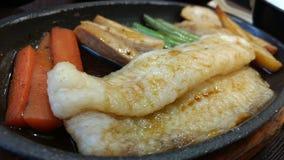 移动式摄影车与菜的鱼排 库存照片