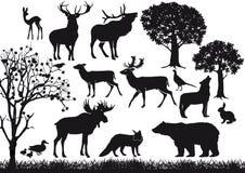 动物和树剪影 免版税库存图片