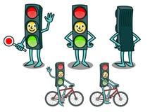 动画片有微笑的面孔的红绿灯 免版税图库摄影