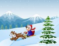 动画片男孩sledding下来在雪由两条狗拉扯了 免版税库存图片