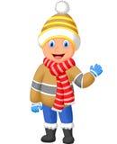 动画片一个男孩在冬天给挥动的手穿衣 图库摄影