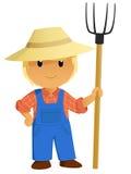 动画片与干草叉的农夫字符 库存照片