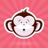 动画片与惊奇的表示的猴子面孔在桃红色背景 库存照片