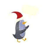 动画片与讲话泡影的圣诞节企鹅 库存照片