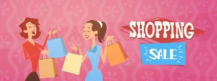 动画片与购物袋大销售横幅的妇女小组 皇族释放例证