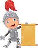 动画片举行空白的公告的骑士男孩 库存照片