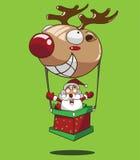 动画片在驯鹿气球的圣诞老人飞行 库存图片