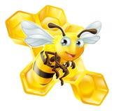 动画片蜂和蜂蜜梳子 免版税库存照片