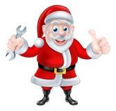 动画片给赞许和拿着扳手的圣诞老人 库存照片