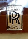 劳斯莱斯商标在棕色汽车的 免版税库存照片