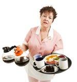 劳累过度的女服务员 库存图片