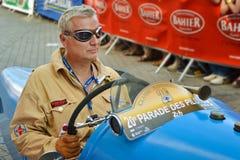 勒芒,法国- 2014年6月13日:游行飞行员赛跑 飞行员驾驶一辆减速火箭的汽车 免版税库存图片