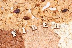 包含自然矿物的题字纤维和成份和维生素、健康生活方式和营养概念 免版税图库摄影