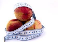 包围的桃子 免版税库存图片