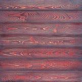 包括木水平的板条的背景上色与红黑油漆 免版税库存照片