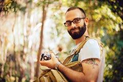 包装照相机到防水框里 库存照片