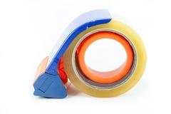 包装的磁带分配器和橡皮膏 库存照片