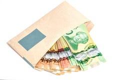 包围查出的货币白色 库存图片