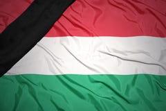 匈牙利的国旗有黑哀悼的丝带的 库存照片