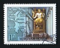匈牙利-大约1980年:在匈牙利打印的岗位邮票由Phidias,古老世界的七奇迹显示宙斯,大约1980年 免版税库存照片