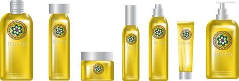 化妆产品黄色塑料,嘲笑,黄色和图表花商标 免版税库存照片