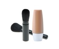 化妆用品画笔和液体构成基础 免版税库存图片