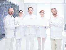 化学实验室科学家队 免版税库存图片